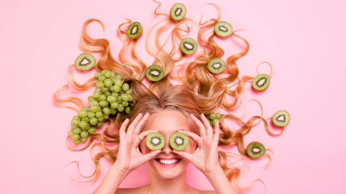 Smiling woman with antioxidant foods in her hair