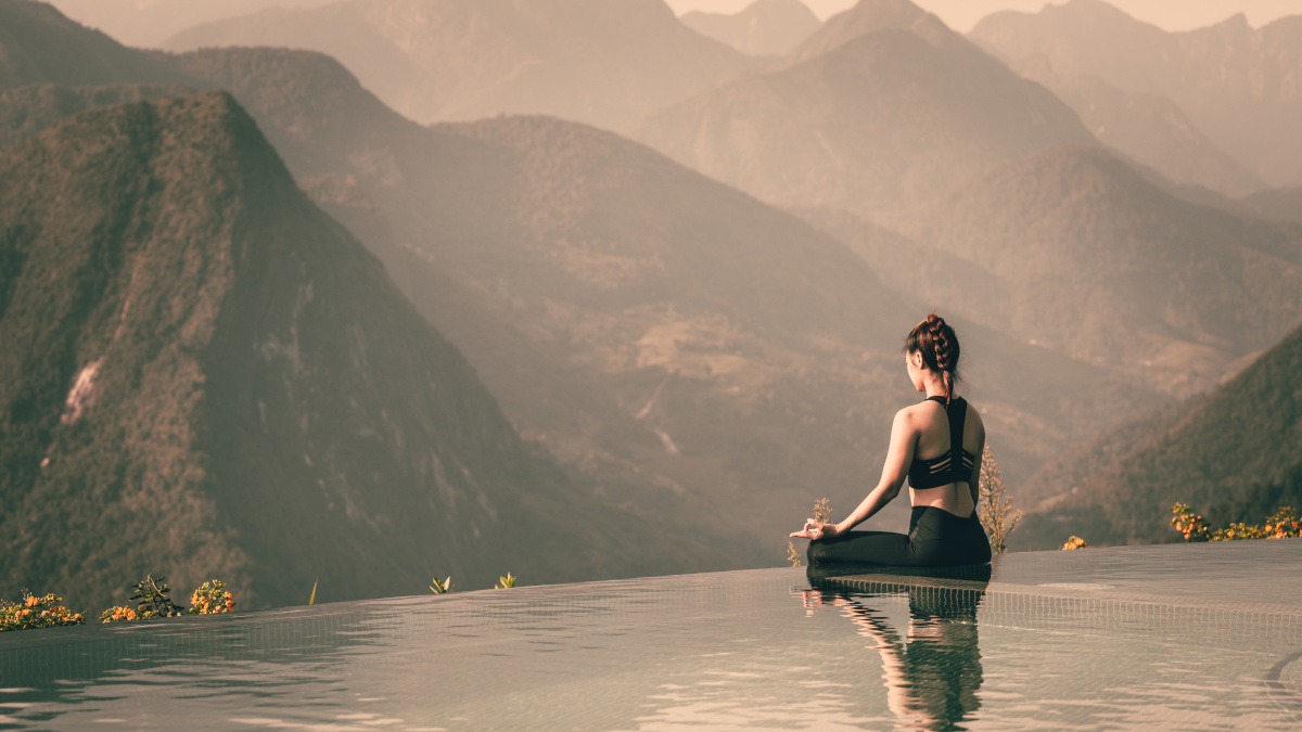 Woman meditating, to control her stress levels